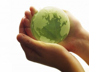 Hands holding green globe - newsletter icon